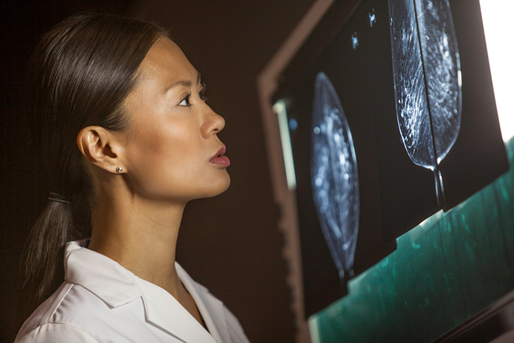 Carestream Health scientist looking at medical image